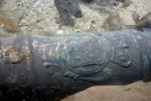 Bronze cannon bearing royal crest of King George I from HMS Victory wreck