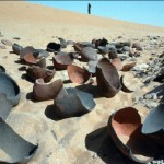 Dessicated water sources and artificial wells made of water pots buried in the sand
