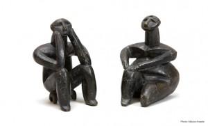 """""""The Thinker"""" and female figurine, fired clay, 5000-4600 B.C."""