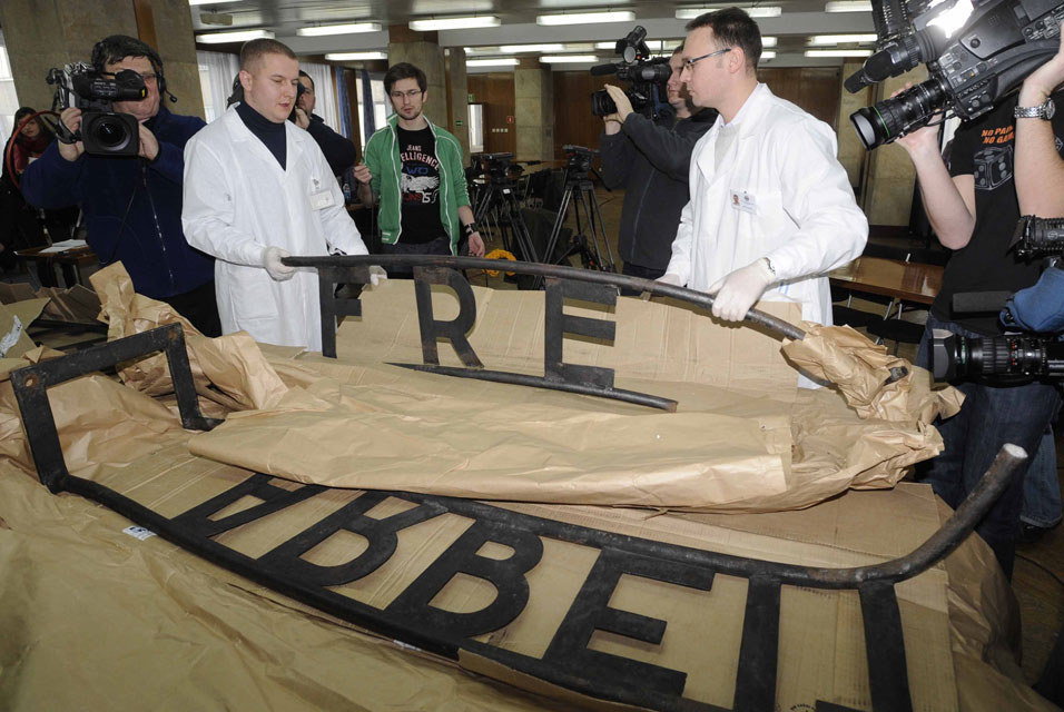 Police display two pieces of the stolen Auschwitz sign