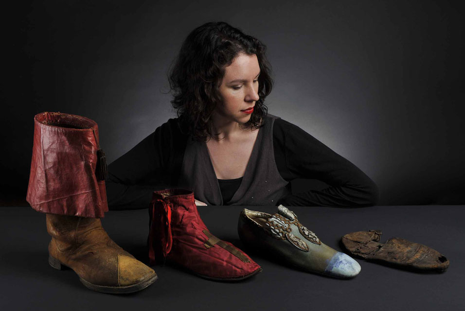 Curator Hilary Davidson and the shoes on display