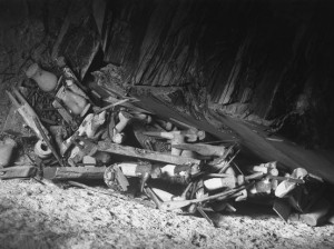 Bits of wooden models in a jumble on the floor of the tomb, 1915