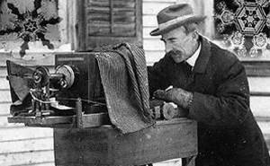 Wilson A Bentley at his microscope/bellows camera apparatus