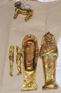 Miniature sarcophagus and gold figurines