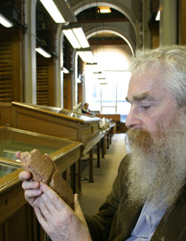 Dr. Irving Finkel examines a clay tablet