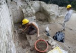 Archaeologists work on palace walls