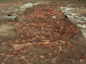 Remains of Greek DIY building, coded roof tiles littering the ground