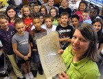 Michelle Eugenio with her students and the 1792 document