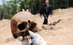 Researcher holds skull found in Vladivostok mass grave