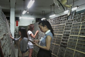 Visitors browse type casts at Ri Xing Type Foundry