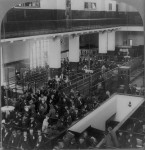 Ellis Island arrivals lined up in the reception hall