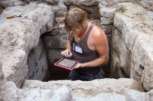 Field researcher records observations about well construction on iPad