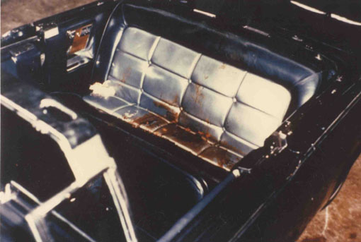 ... watches the coffin of President John F. Kennedy pass on Nov. 25, 1963