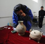 Liu Daiyun examines liquid thought to be wine
