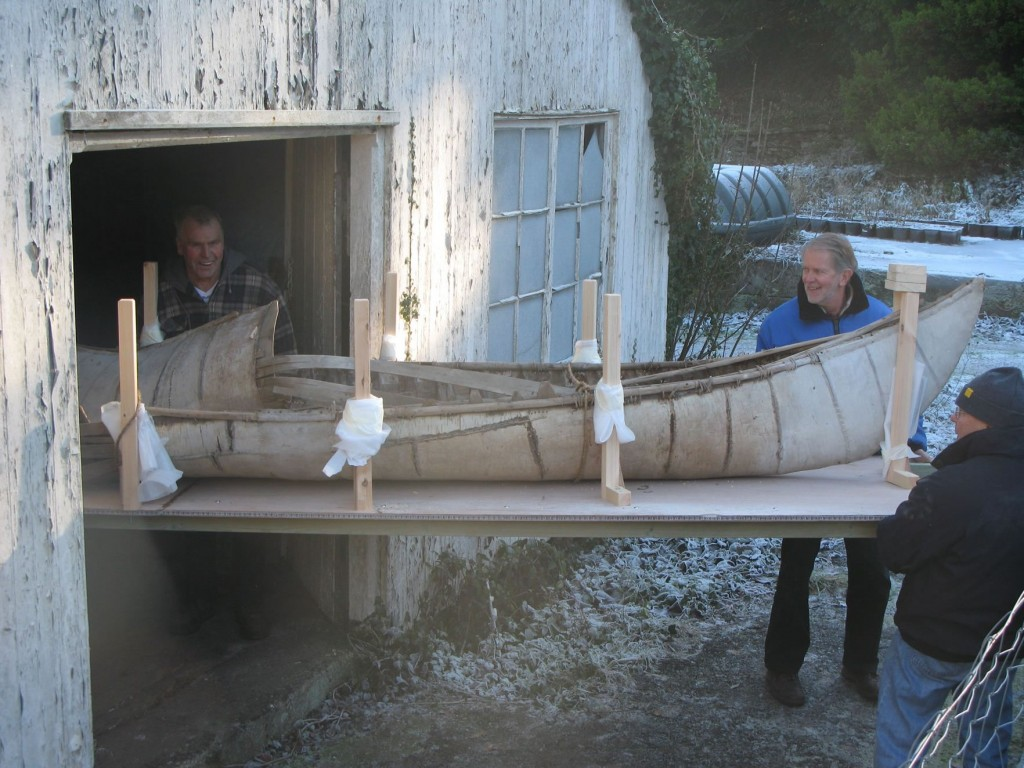18th c. birch-bark canoe being taken out of its Cornwall shed