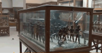 Broken display case in Cairo Museum, still from Al Jazeera footage