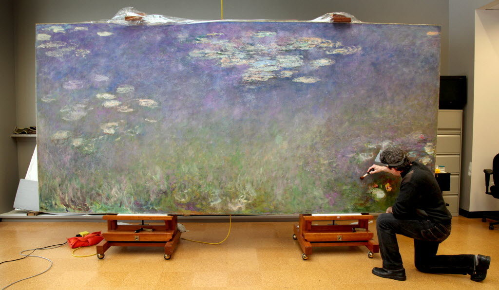 "Dean Yoder, Cleveland Museum of Art, cleans left panel of Monet's ""Water Lilies"" triptych"