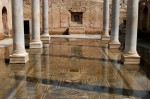 Colonnaded atrium with mosaic floor as the water encroaches