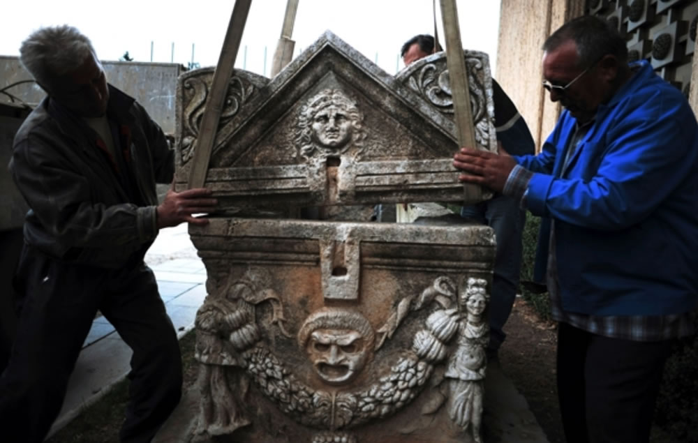 Workers unload 1st c. A.D. Roman sarcophagus at National Museum in Sofia