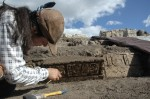 Archaeologist Luz Evelia cleans glyphs with bamboo skewer at El Palmar