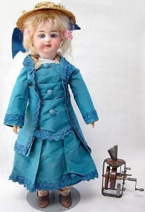 Edison Phonograph Doll, internal phonograph mechanism shown right