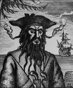 Engraving of Blackbeard, hair woven with flaming fuses, ca. 1715
