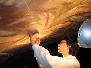 Restorer Rosa María Montes applies bacteria gel to church fresco