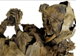 Mummy with hands clasped in prayer
