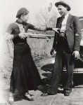 Bonnie aiming a Winchester at Clyde, picture confiscated after the Joplin raid