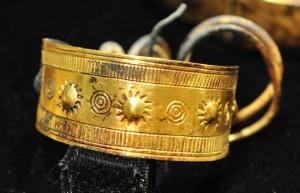 Gold cloak pin