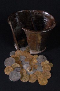 Silver and gold coins, ring, ceramic vessel buried during English Civil War found in High Ackworth yard