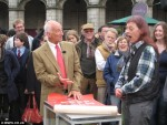 Moragh Turnbull and Paul Atterbury with posters at Antiques Roadshow