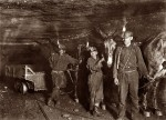 West Virginia coal miners and mules with open flame lamps, 1908