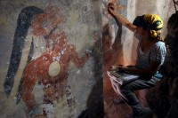 Conservator Angelyn Bass cleans and stabilizes Maya mural