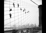 Painters hang from suspension wire on the Brooklyn Bridge, taken by de Salignac, October 7, 1914
