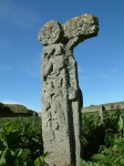 Carved Celtic cross on Canna; pieces have broken off and are now in the island museum