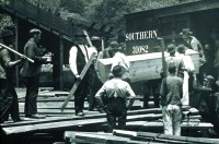 Bodies of miners being loaded into a train