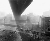 Horse carts under Brooklyn Bridge, May 6, 1918