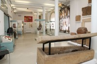 Newly refurbished Clark Gallery of the Museum of Archaeology & Anthropology, coffin in foreground