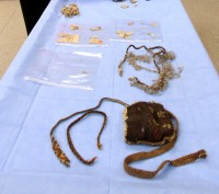 From front to back: purse, slings, netted bag with hair strap, newspaper fragments