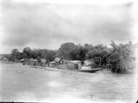 River or lakeside village, location unknown