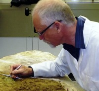 Neil Mahrer from Jersey Heritage excavates the block