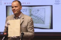 Royal Library map librarian Greger Bergvall holds Wytfliet Atlas at New York press conference Wednesday