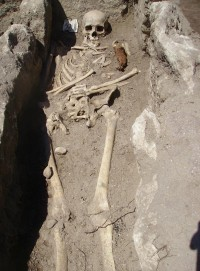 Skeleton with iron ploughshare in the chest