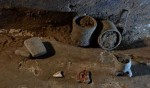 Pottery vessels, metate, a sea shell fragment in the second burial chamber