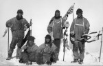 Scott's team at South Pole, Scott standing in the middle next to the flag