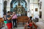 Tourists get their picture taken with the Jesus Monkey, photo by Gorka Lejacegi