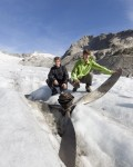 Manuel Ruefener and Peter Fluehmann pose near the excavated propeller