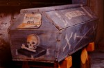Decorated coffin of a miner, tools of the trade painted on the side