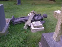 Bronze angel on Matarazzo grave knocked down and cross toppled on top of it